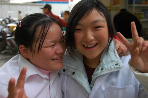 These shy girls turned into giggling hams when the camera came out. Taken in Shanghai, China.